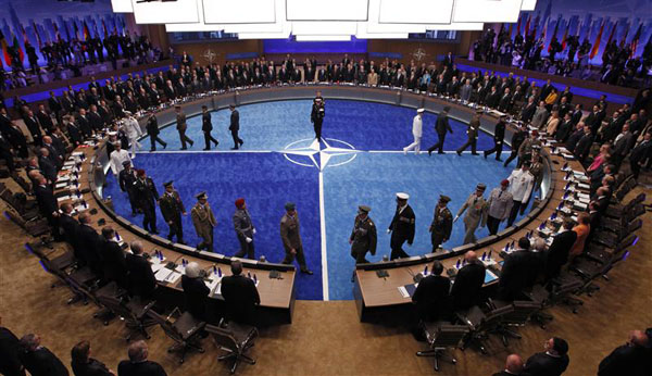 Leaders watch a ceremony honoring NATO military personnel for their service the NATO Summit meeting in Chicago
