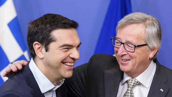 European Commission President Jean-Claude Juncker, right, welcomes Greece's Prime Minister Alexis Tsipras upon his arrival at the European Commission headquarters in Brussels Friday, March 13, 2015. (AP Photo/Geert Vanden Wijngaert)