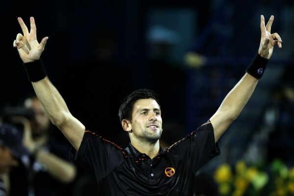 Serbia's Novak Djokovic celebrates after winning the Dubai ATP Open final Tennis match against Swiss Roger Federer on February 26, 2011 in Dubai. Djokovic won 6-3, 6-3.   AFP PHOTO / KARIM SAHIB (Photo credit should read KARIM SAHIB/AFP/Getty Images)