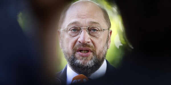 Social Democratic top candidate for Europe (SPE) Martin Schulz , member of the SPD party in Germany, speaks to journalists after he casted his vote in a ballot box at a polling station in Wuerselen, Germany, Sunday, May 25, 2014. Some 400 million people in Europe are called to vote for a new parliament. (AP Photo/Frank Augstein)