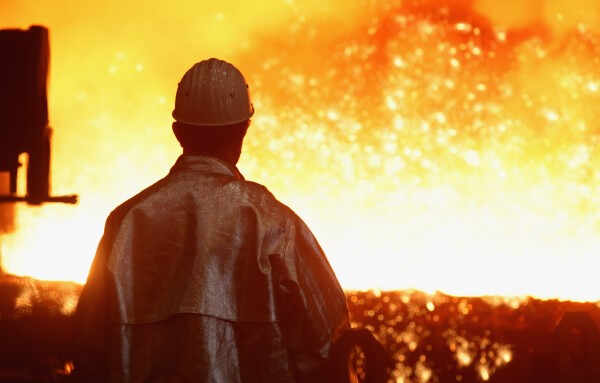 DUISBURG, GERMANY - JANUARY 13:  A worker watches as sparks fly from molten iron heated to approximately 1480 degrees Celsius flowing from a blast furnace at the ThyssenKrupp steelworks on January 13, 2010 in Duisburg, Germany. Recent economic data, including better-than-expected unemployment figures and a positive trend in manufacturing orders in the last quarter, are giving economists hope that the German economy is recovering faster than expected from the effects of the global financial crisis. ThyssenKrupp is Germany's biggest steel producer and is building new mills in Brazil and Alabama.  (Photo by Sean Gallup/Getty Images)