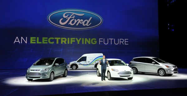 Bill Ford, Executive Chairman of Ford Motors stands with (L-R) the C-MAX electric car, the Transit Connect electric truck, the Focus electric car and the C-MAX hybrid during the first press preview day at the 2011 North American International Auto Show January 10, 2011 in Detroit, Michigan. AFP PHOTO/Stan HONDA (Photo credit should read STAN HONDA/AFP/Getty Images)