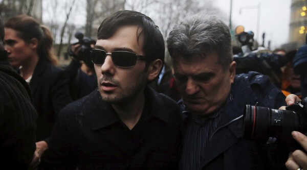 Martin Shkreli (C), chief executive officer of Turing Pharmaceuticals and KaloBios Pharmaceuticals Inc, departs U.S. Federal Court after an arraignment following his being charged in a federal indictment filed in Brooklyn relating to his management of hedge fund MSMB Capital Management and biopharmaceutical company Retrophin Inc. in New York December 17, 2015. REUTERS/Lucas Jackson
